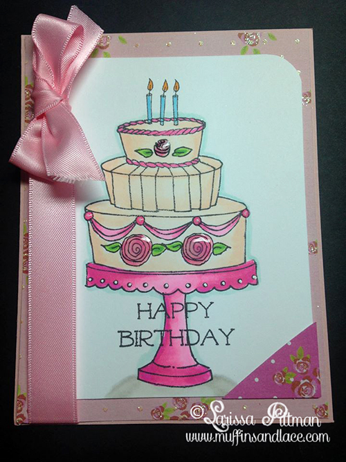 Designed by Larissa Pittman of Muffins and Lace for Paper Wings Productions cardfront with ribbon